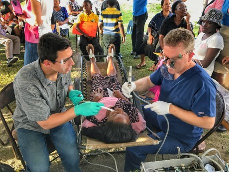 guyana-dr-simpson-and-aaron-with-patient-460x345