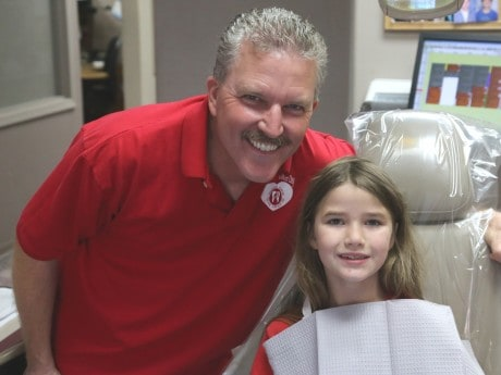 Pictured above is Dr. Dwight Simpson with Olivia, who was happy to be seen and get her teeth cleaned.