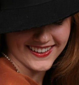 Girl in a hat smiling