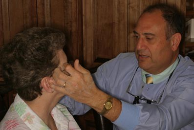 Doctor treating a patient for TMJ